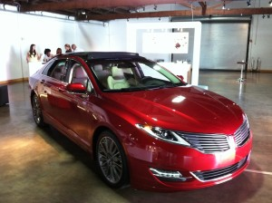 The Lincoln MKZ, with museum-like presentations of Panther Coffee and Wynwood Cigar Company in the background
